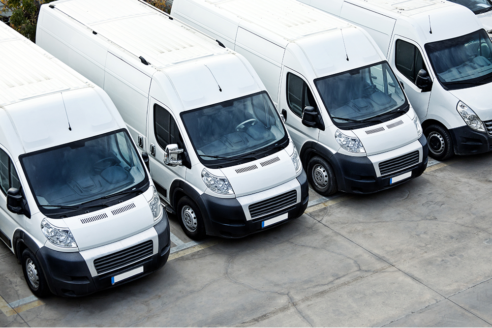 row of commercial vehicles depicting work vans