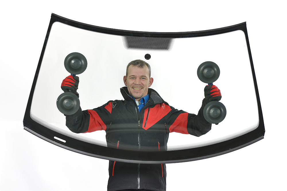 image of a man holding a new windscreen